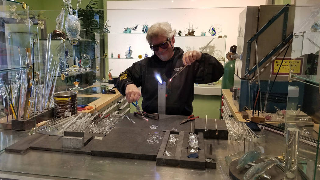 Celia Shortt Goodyear/Boulder City Review Dan Thompson works on a piece of glass art at Boulder City Florist, 1229 Arizona St. He owns the business with his wife, Kris, a master floral designer.