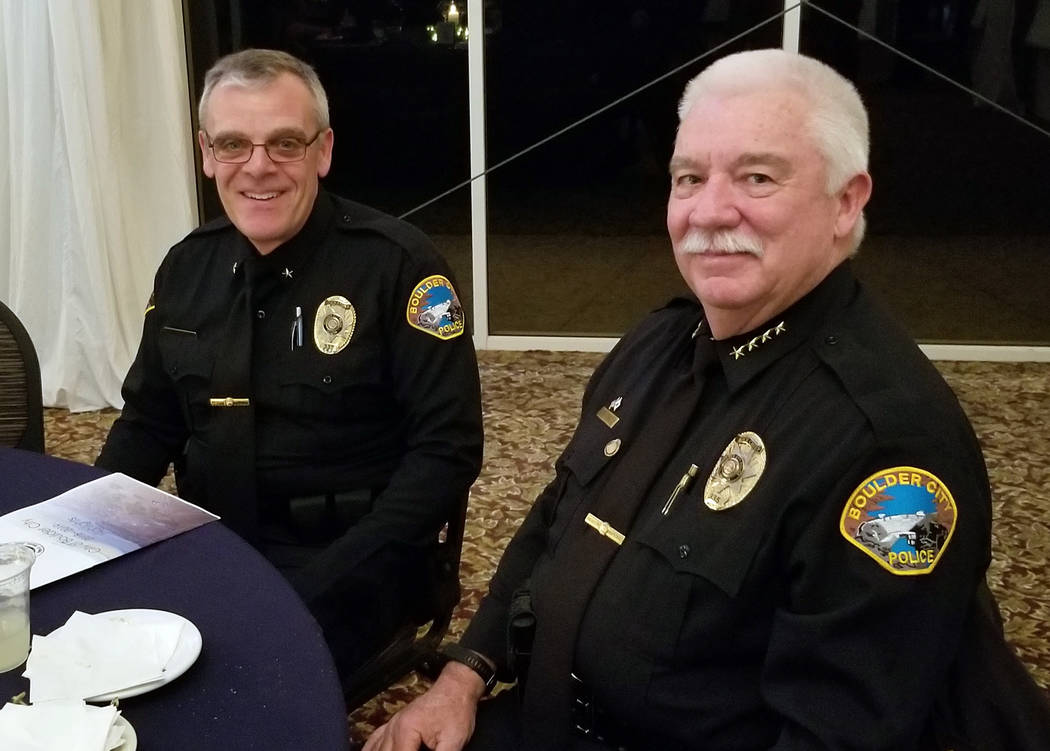 (Celia Shortt Goodyear/Boulder City Review) Boulder City Police Commander Brent Speyer, left, and Boulder City Police Chief Tim Shea enjoy a conversation at the mayor's State of the City on Thursd ...