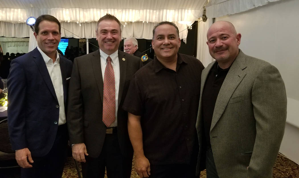 (Celia Shortt Goodyear/Boulder City Review) Jim Ferrence, from left, City Manager Al Noyola, Mike Pacini and Rob Martello take time out for a quick picture at the mayor's State of the City address ...