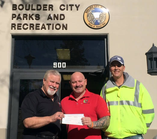 (Roger Hall) Roger Hall, left, director of parks and recreation for Boulder City, accepts a donation from Robert Martello, center, of Boulder City Disposal, Boulder Disposal and Waste Logistic NV ...