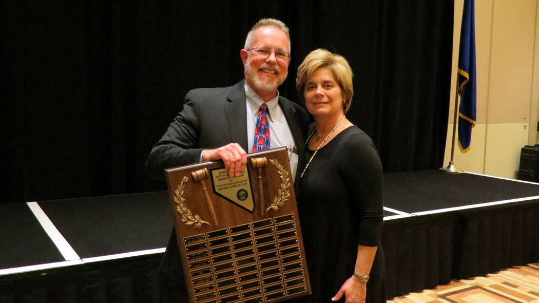 (Boulder City) Judge Victor Miller receives the 2018 Judge of the Year award from Judge Diana Sullivan of the Las Vegas Justice Court at the Nevada Judges of Limited Jurisdiction's annual banque ...