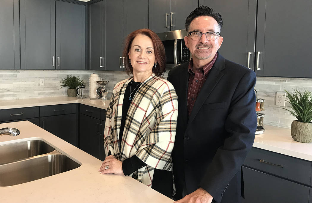 (Hali Bernstein Saylor/Boulder City Review) Catherine and Wayne Laska, principals of Storybook Homes, were on hand to help show area officials and real estate professionals the new model homes at ...