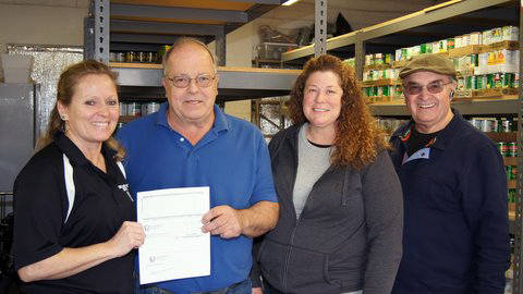 (Kelly Lehr) Boulder City Parks and Recreation Department donated $240, the proceeds from its holiday dodgeball tournament, to Emergency Aid of Boulder City to help stock its pantry. Here, from le ...