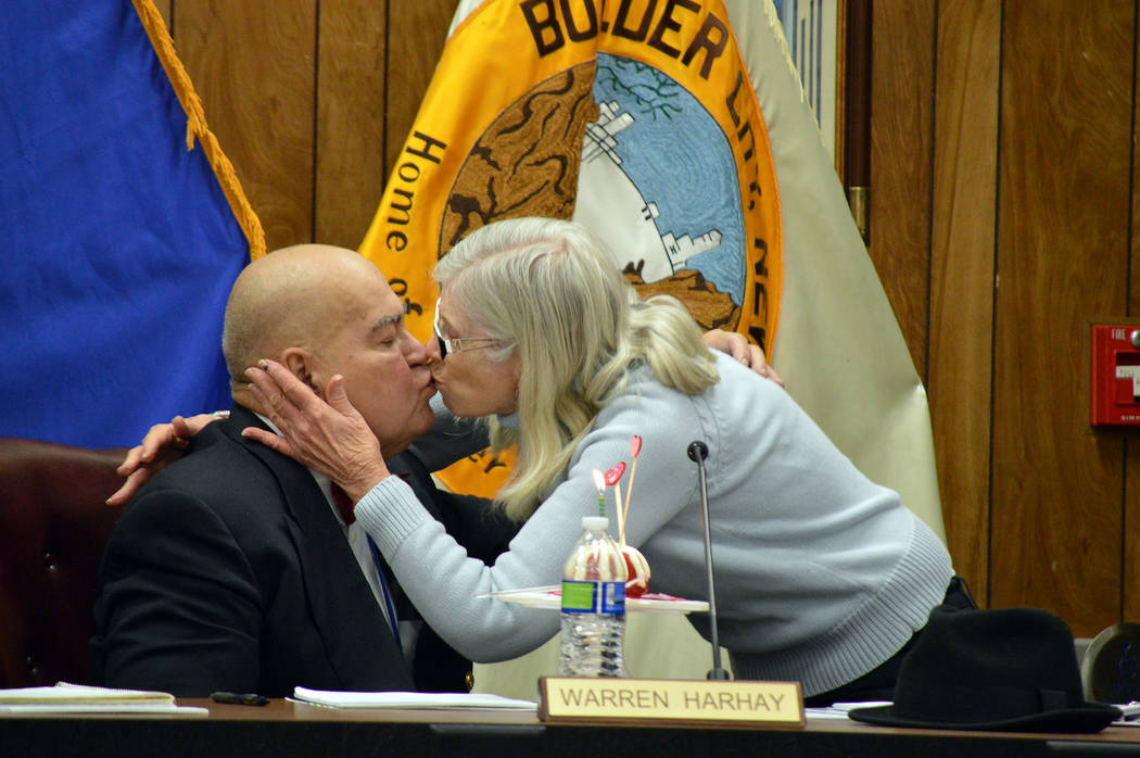 (Celia Shortt Goodyear/Boulder City Review) Marcia Harhay, wife of Councilman Warren Harhay, presents him with a belated birthday cake. City Manager Al Noyola has made a practice of recognizing co ...