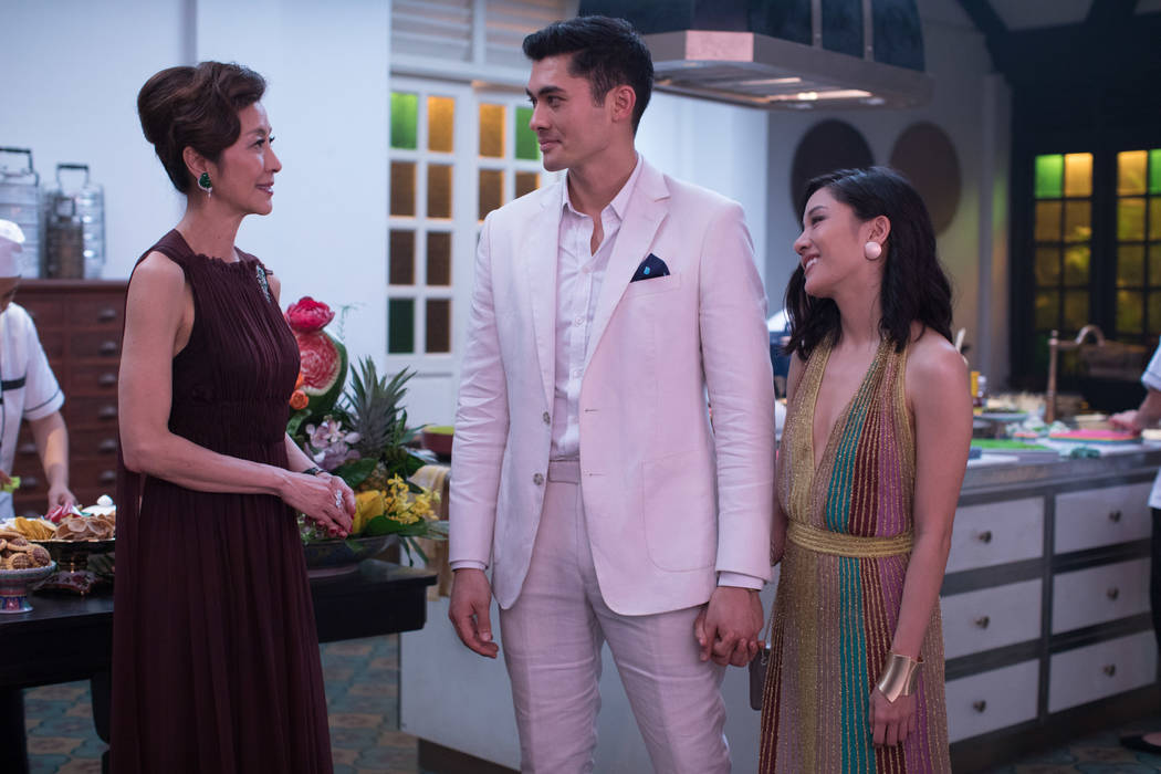"Michelle Yeoh as Eleanor, Constance Wu as Rachel and Henry Golding as Nick in ""Crazy Rich Asians."" (Sanja Bucko/Warner Bros.)"