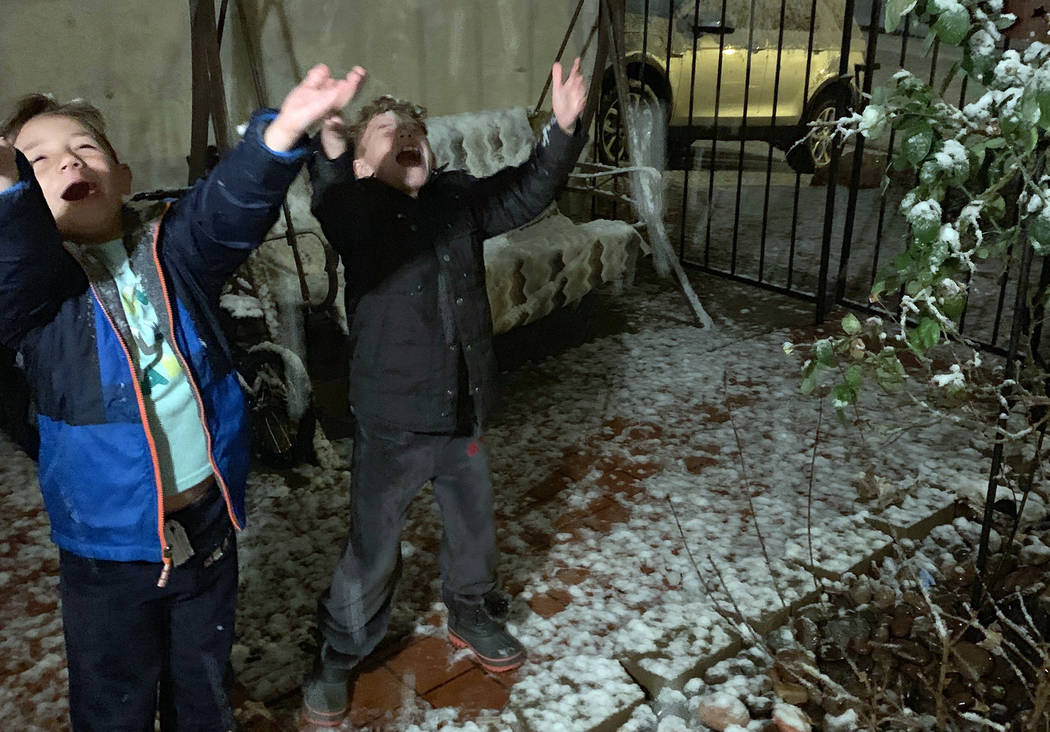 (Jasmine Urioste) Colton, left, and Cash Urioste play in the snow that fell in Boulder City on Sunday evening.