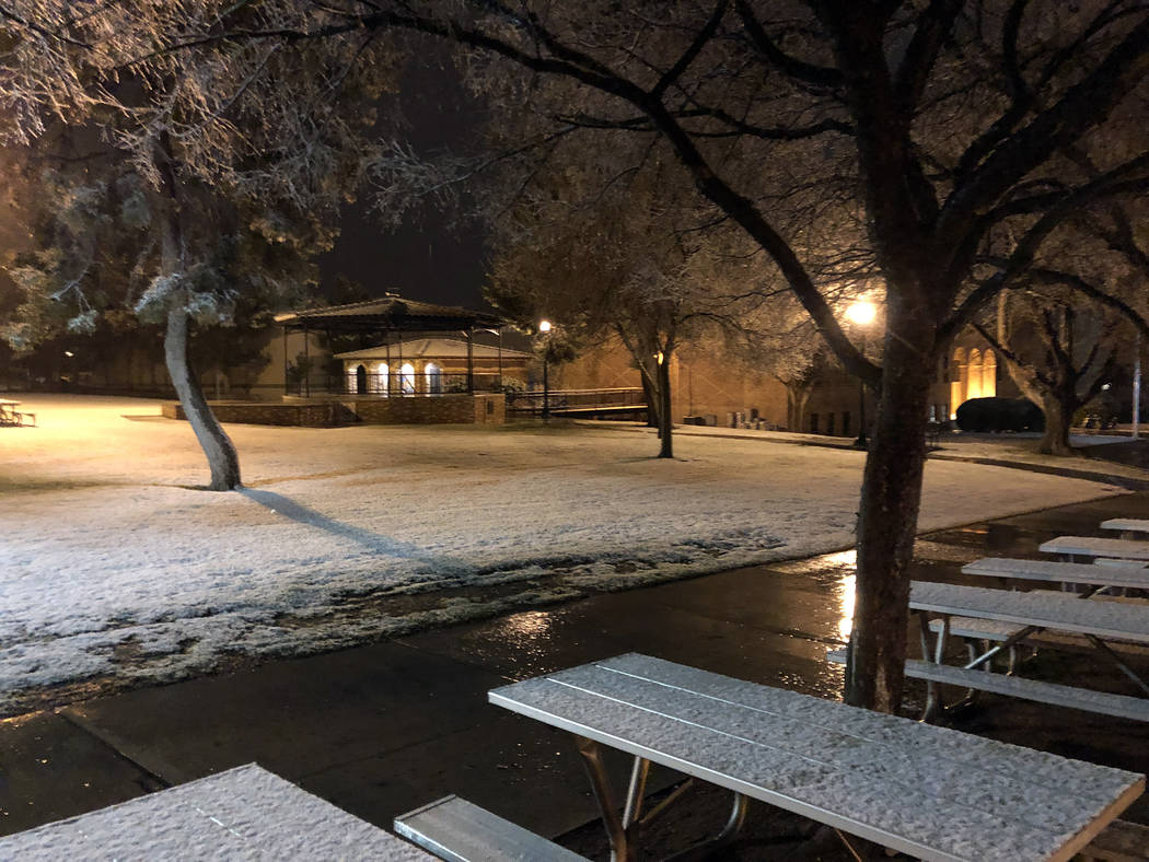 (Brok Armantrout) Snow covers the picnic tables and grounds of Bicentennial Park near City Hall in Boulder City.