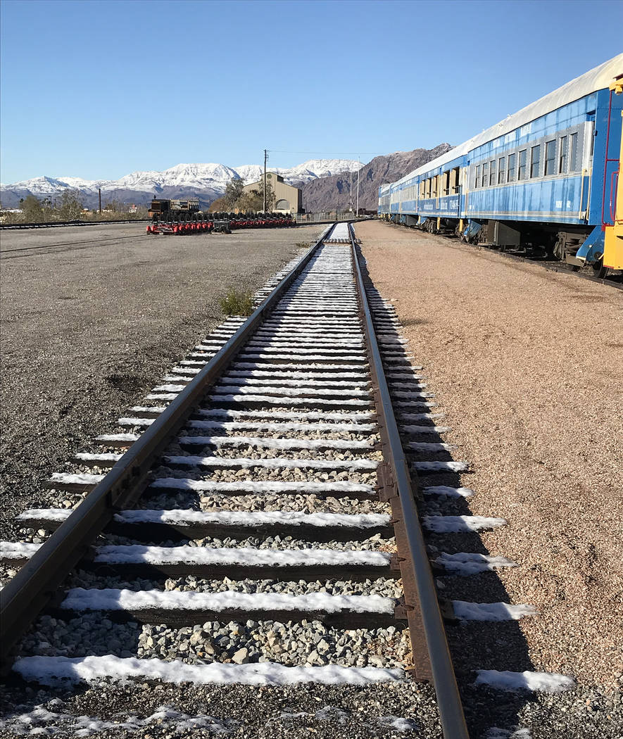 (Hali Bernstein Saylor/Boulder City Review) Snow melts on the tracks of the Nevada State Railroad Museum in Boulder City on Monday, Feb. 18, 2019, after about an inch fell Sunday night. The mounta ...
