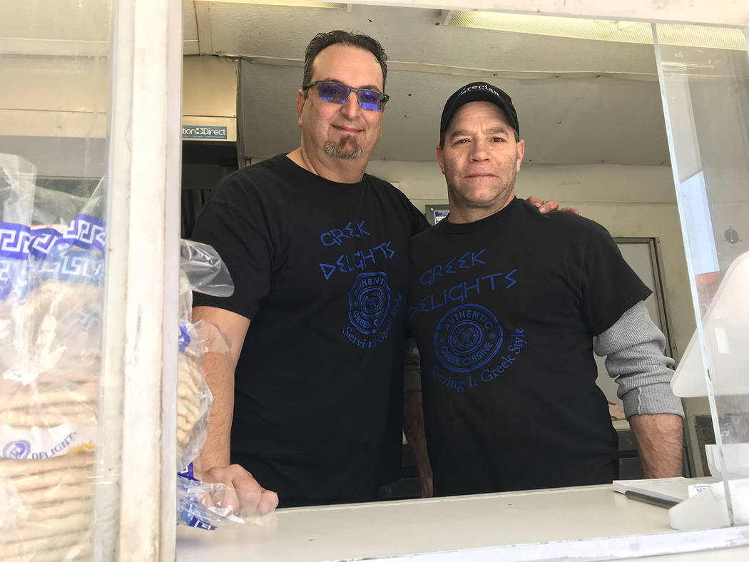 (Hali Bernstein Saylor/Boulder City Review) Dion Katsoris, left, and John Real serve an assortment of Greek dishes at the Greek Delights food truck at 2Wheels.