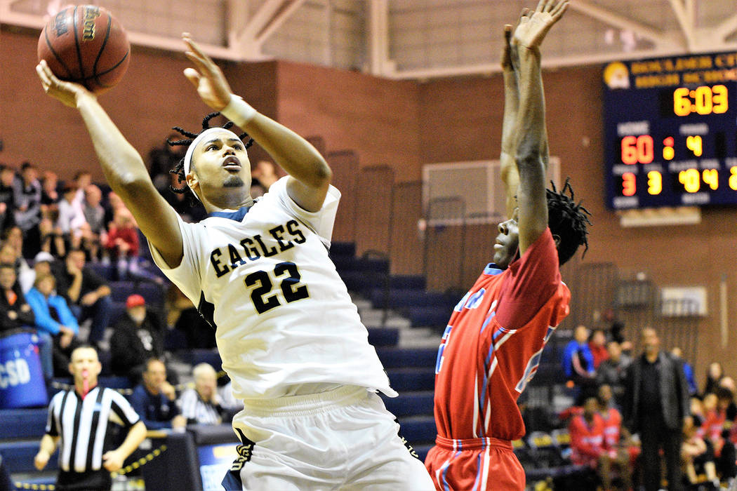 (Robert Vendettoli/Boulder City Review) Creating space, senior forward Derrick Thomas steps back for a midrange jump shot against Western in the first round of the Class 3A postseason Tuesday, Feb ...