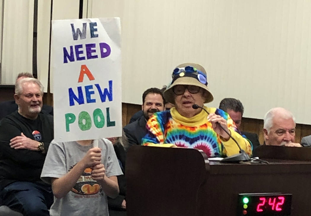 Boulder City Jan Miller and her grandson show their support of a new pool during Tuesday's City Council meeting on Feb. 26.