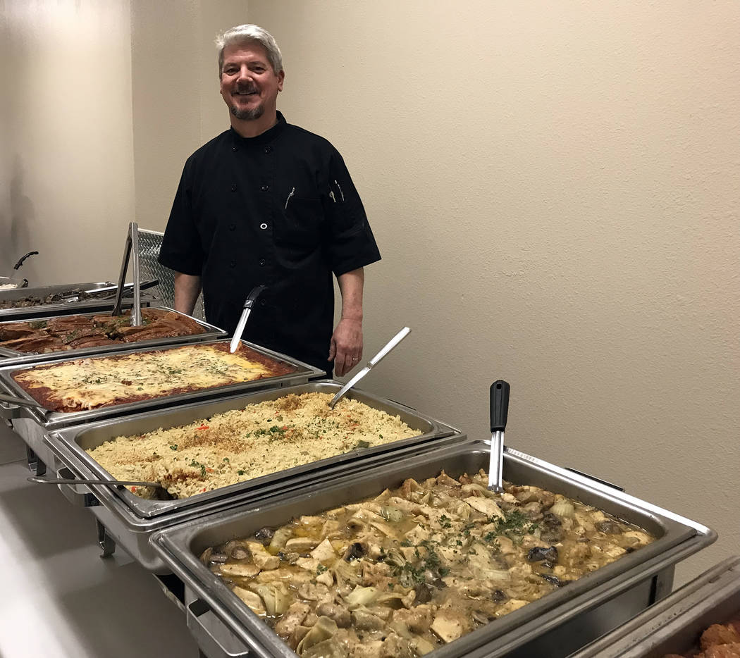 (Hali Bernstein Saylor/Boulder City Review) Evan Lathouris of Evan's Old Town Grille makes sure everything is in place for the Boulder Dam Credit Union's annual membership meeting and dinner. He h ...