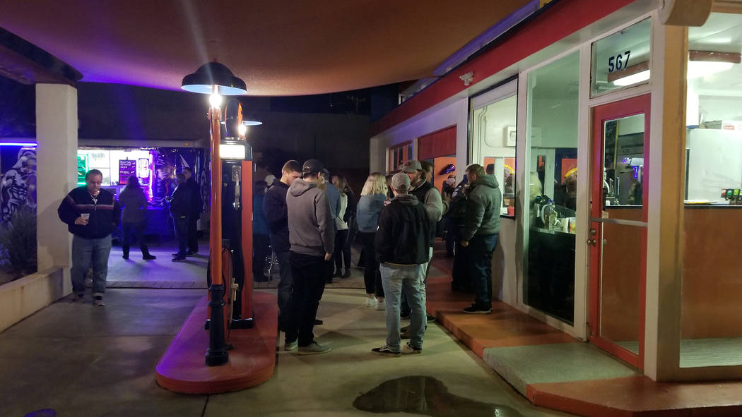 (Celia Shortt Goodyear/Boulder City Review) Guests enjoy their drinks and the warmer temperatures at 2Wheels Garage Grill during the third annual Xi Zeta Rosie Roll pub crawl on Friday, Feb. 22.