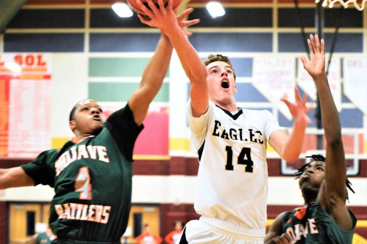 (Robert Vendettoli/Boulder City Review) Fighting through contact, senior forward Karson Bailey drives to the rim for a layup against Mojave in the 3A Southern Region semifinals at Del Sol High Sch ...