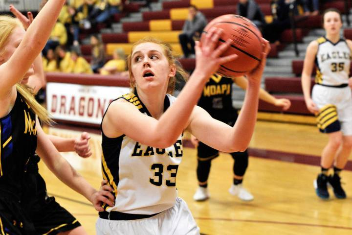 (Robert Vendettoli/Boulder City Review) Making her way inside the paint, junior forward Ellie Howard backs down her opponent against Moapa Valley on Monday, Feb. 25, in the 3A Southern Region fina ...