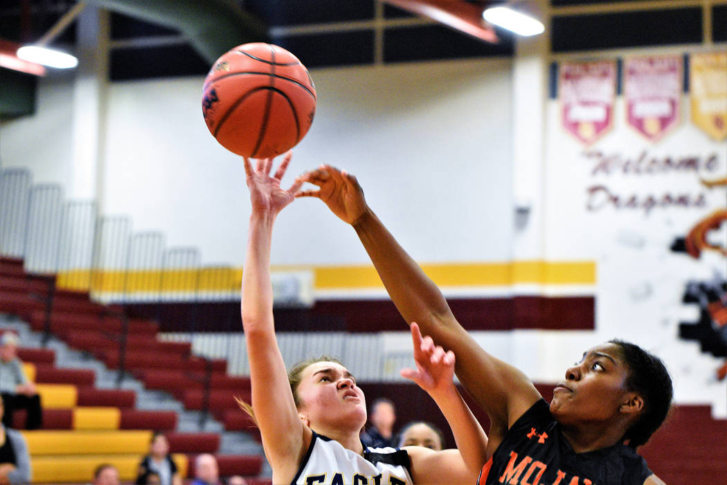 (Robert Vendettoli/Boulder City Review) Junior guard Keely Alexander slashes her way to the basketball for a layup against Mojave in the 3A Southern Region semifinals on Feb. 23. Boulder City lost ...