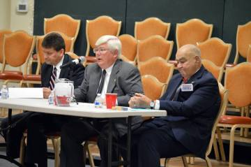 (Celia Shortt Goodyear/Boulder City Review) The three Boulder City mayoral candidates, from left, Mayor Rod Woodbury, Councilman Kiernan McManus and Councilman Warren Harhay, participate in a cand ...