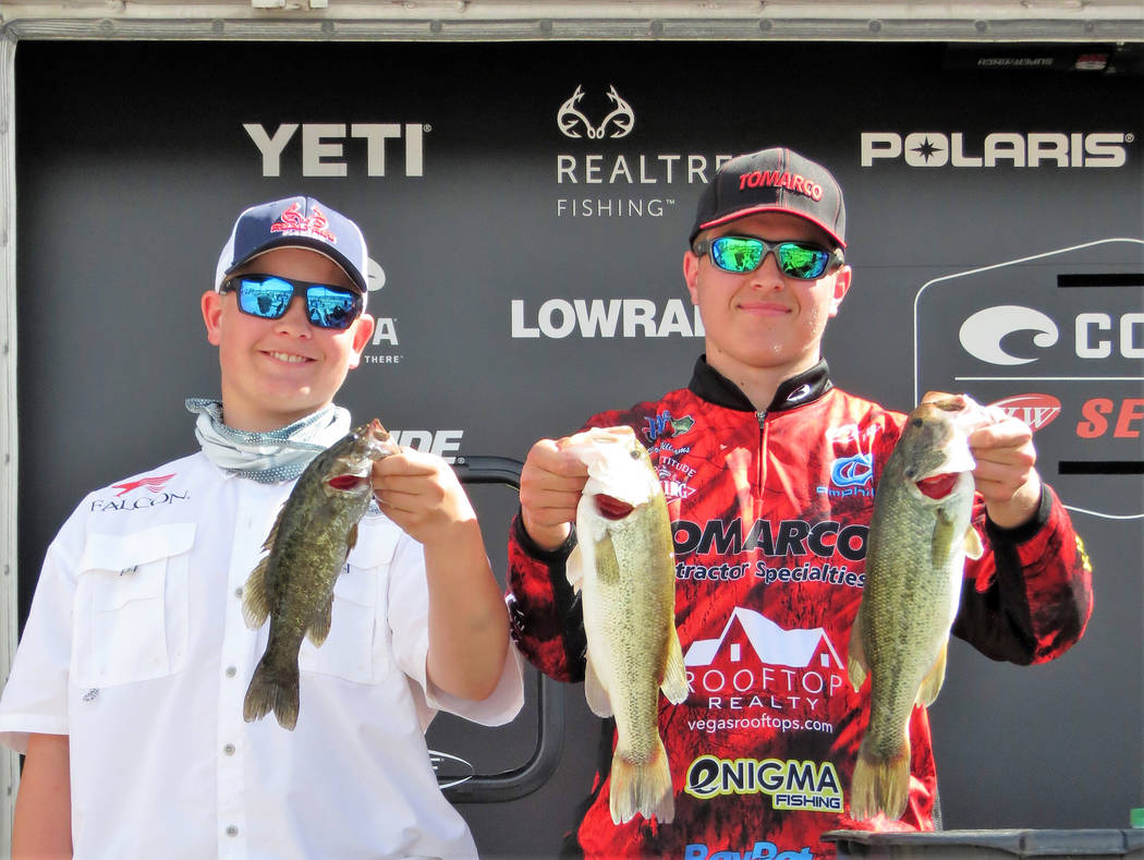 (Boulder City Bass Club) Izec Easter, left, and Corey Williams show off their bass haul at the 2019 Bass Pro Shops FLW High School Fishing Lake Mead Open on Sunday, March 4. The duo earned first p ...