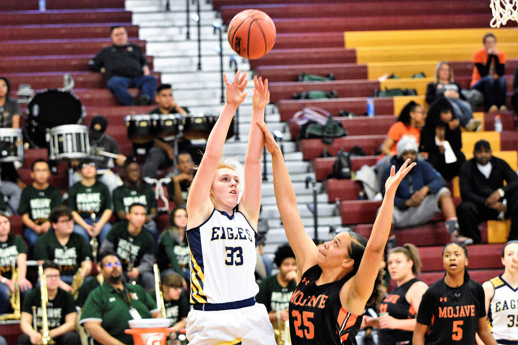 (Robert Vendettoli/Boulder City Review) Boulder City High School's junior forward Ellie Howard, seen rising above a Mojave defender in the 3A Southern Region semifinals Feb. 23, 2019, was named th ...