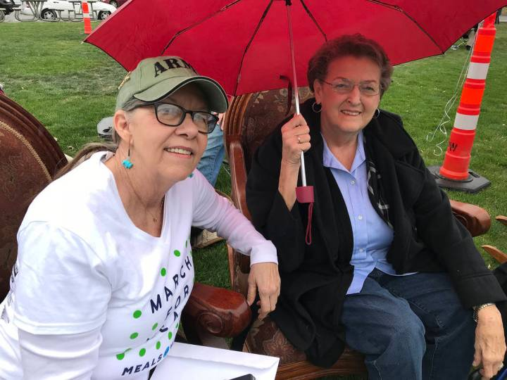 Hali Bernstein Saylor/Boulder City Review Jennie Smith, left, and Jeanne Thompson, volunteers at the Senior Center of Boulder City, didn't let a little rain stop them from rocking in rocking chair ...