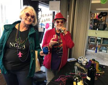 (Hali Bernstein Saylor/Boulder City Review) Boulder City residents Dawn Walker, left, and Jane Mollison get into the spirit of the Mardi Crawl during the Best Dam Wine Walk on Saturday, March 9, 2019.