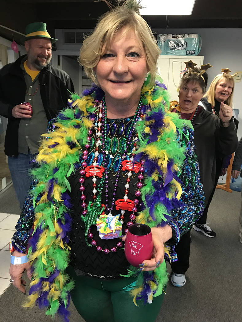 (Hali Bernstein Saylor/Boulder City Review) Lisa Porter Sutter of Henderson shows off her Mardi Crawl outfit featuring attire from Mardi Gras in New Orleans during the Best Dam Wine Walk in downto ...