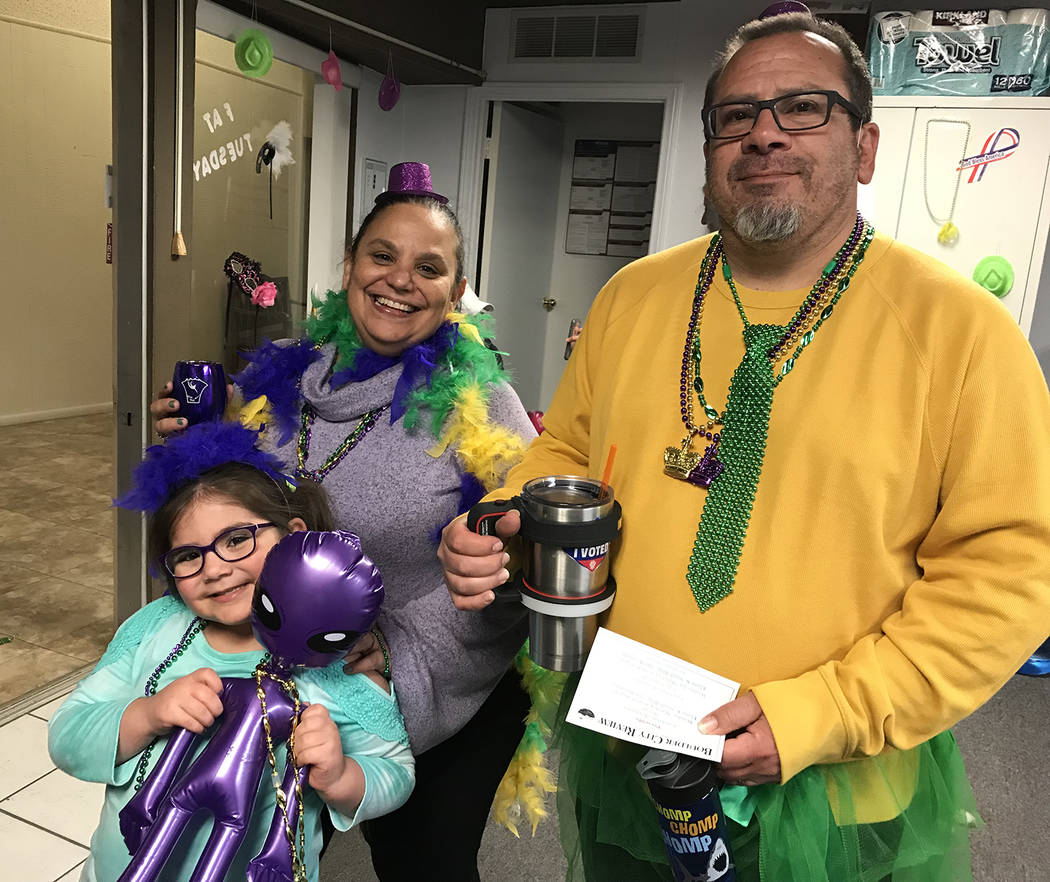 (Hali Bernstein Saylor/Boulder City Review) Vanessa and David Cohen of Boulder City and their daughter, Leora Rose Cohen, dressed in feathers, tutus and beads for Saturday's, March 9, 2019, Mardi ...