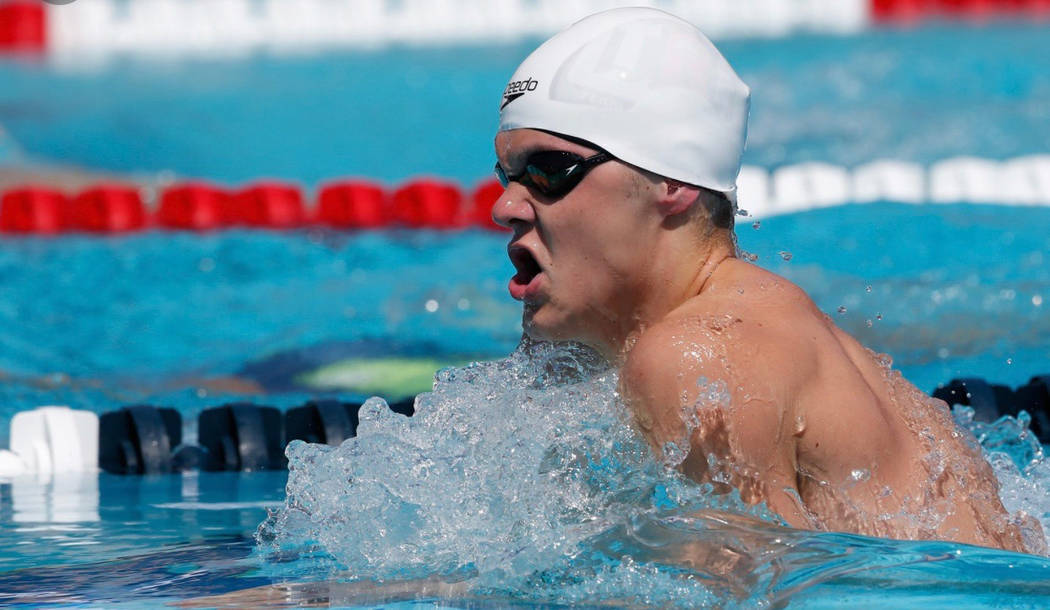 (File) Boulder City High School senior A.J. Pouch, seen swimming the 200-meter breaststroke in August at the Speedo Junior Nationals in Irvine, California, is gearing up for a run at the state cha ...