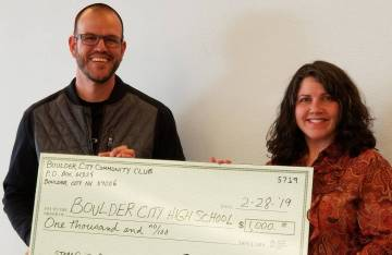 (Boulder City Community Club) Joshua Fisher, who coordinators the STEM guitar program at Boulder City High School, accepts at $1,000 donation from the Boulder City Community Club Treasurer Carmela ...