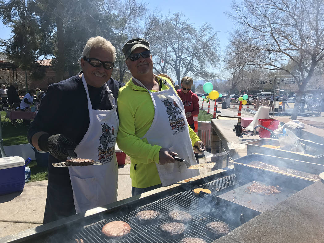 (Hali Bernstein Saylor/Boulder City Review) Dale Ryan, left, and Andy Anderson manned the barbecue grill, cooking hamburgers and hot dogs, at Saturday's, March 16, 2019, Rock, Roll & Stroll to ...