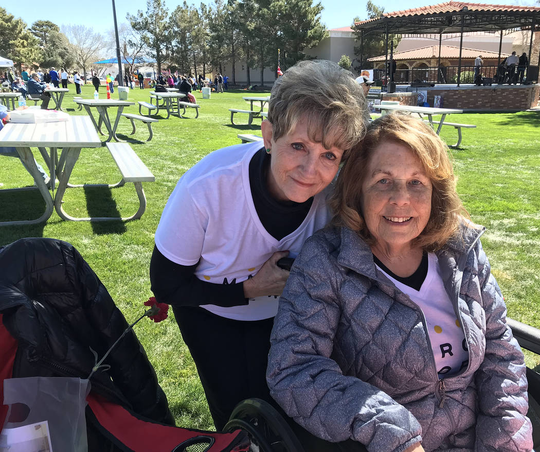 (Hali Bernstein Saylor/Boulder City Review) Kathy Emling, left, president of the Senior Center of Boulder City's board of directors, and Sharon Imlay manned a table filled with baked goods in Bice ...