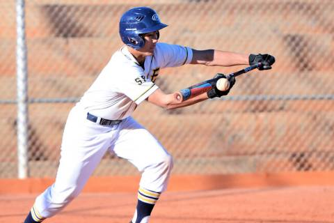 (Robert Vendettoli/Boulder City Review) Laying down a successful bunt, Boulder City High School sophomore Deavin Lopez reached first base safely in the Eagles' 10-0 victory over Western on March 1 ...