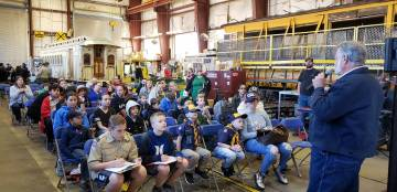 (Nevada State Railroad Museum) Rowland Fogarty, right, a retired Union Pacific engineer, discussed railroading careers with Scouts on Saturday, March 16, 2019, as they visited the Nevada State Rai ...