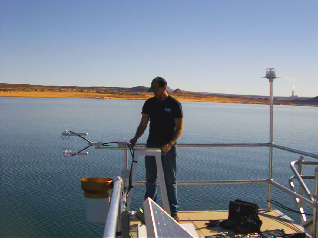 (Chris Pearson/Desert Research Institute) A researcher adjusts equipment during installation of ...