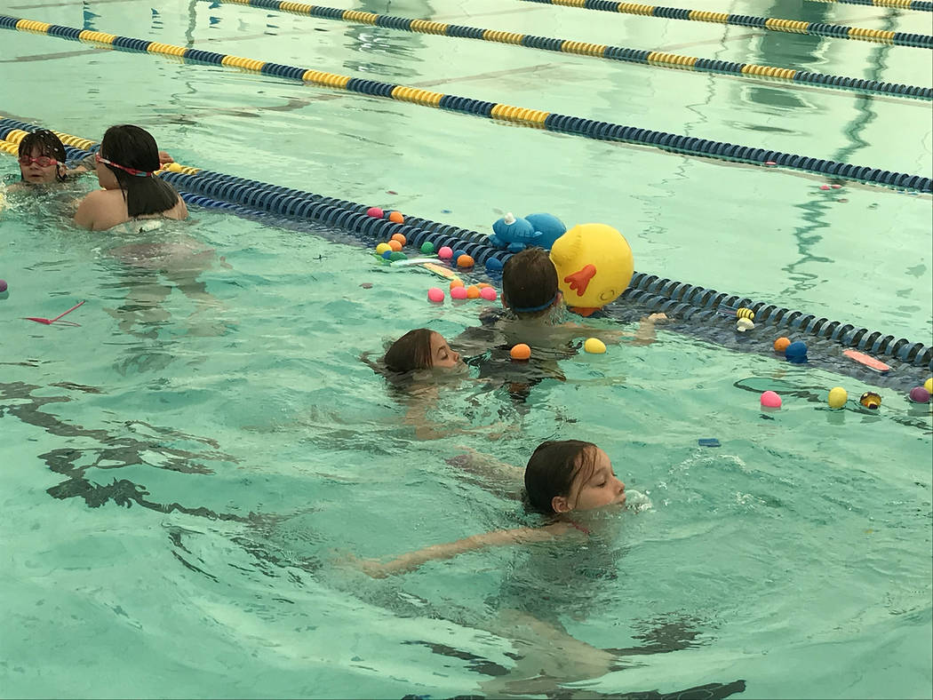 (Hali Bernstein Saylor/Boulder City Review) Children took the plunge Saturday, April 6, to sear ...