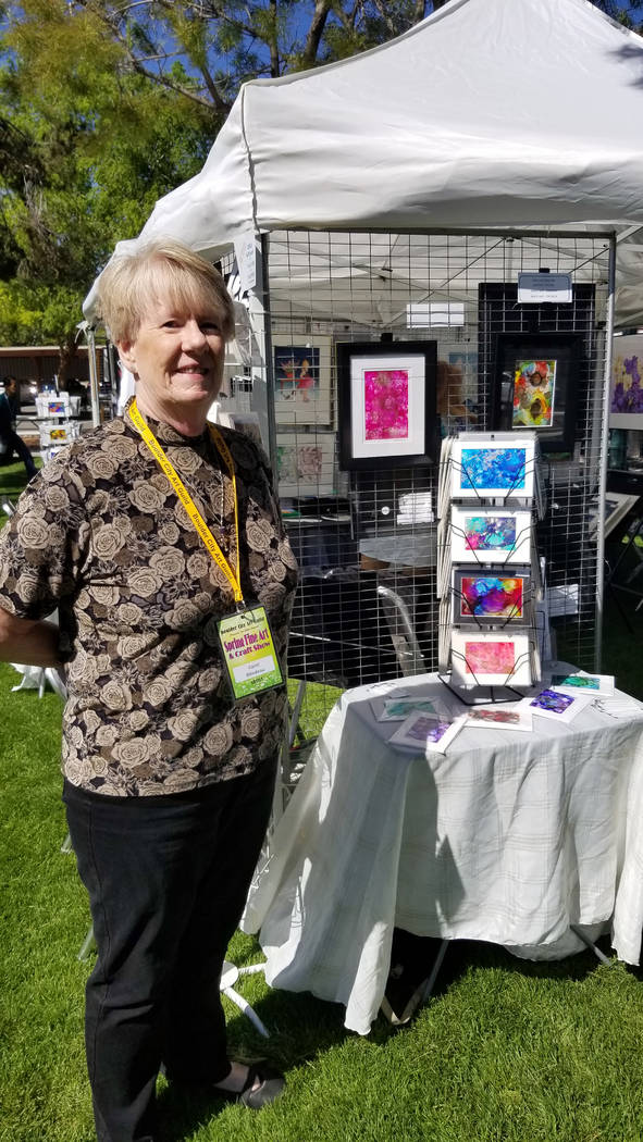 (Celia Shortt Goodyear/Boulder City Review) Carol Bilodeau showcases her alcohol ink paintings ...