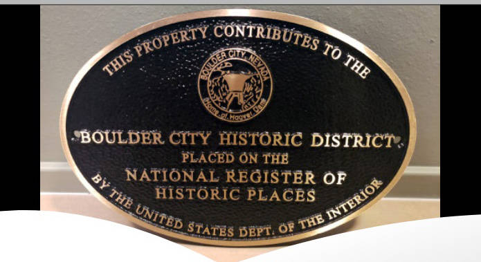 Plaques recognizing a property's contribution to the Boulder City Historic District are availab ...