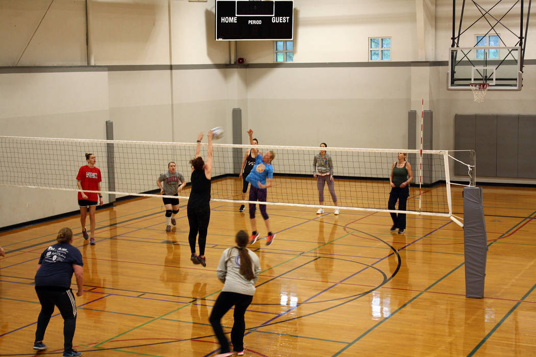 (Kelly Lehr) Roxanne Lamar from The Amazons hits against a block from Bridget Martorano from Bo ...