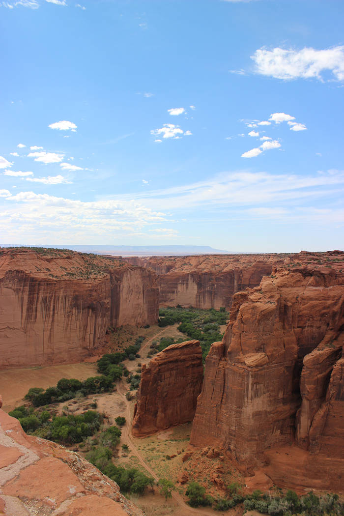 (Deborah Wall) Red sandstone cliffs rise up 1,000 feet from the valley floor in Canyon de Chell ...