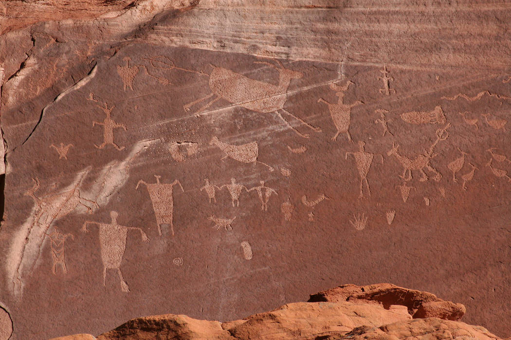 (Deborah Wall) Rock art such as pictographs and petroglyphs, the latter seen here, can be found ...