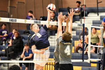 (Robert Vendettoli/Boulder City Review) Rising above the net, junior Dylan Leasure spikes the b ...