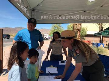 (Hali Bernstein Saylor/Boulder City Review) Ranger Sylvia McMartin, right, welcomes Landry Chan ...