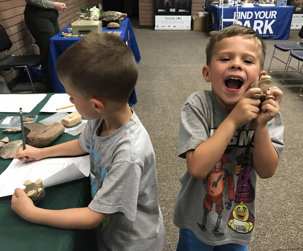 (Hali Bernstein Saylor/Boulder City Review) Six-year-old twins Alexander, left, and Nicholas Pe ...
