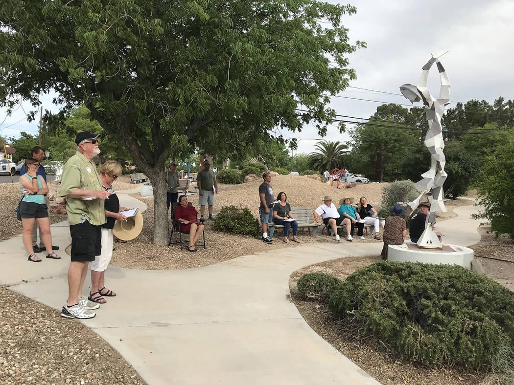 (Hali Bernstein Saylor/Boulder City Review) A group listens for clues as Boulder City History & ...
