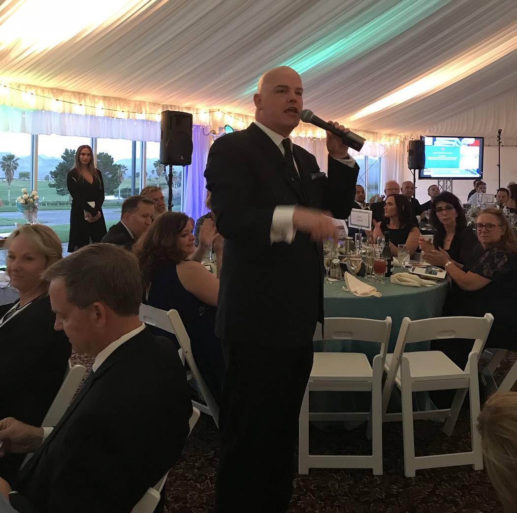 Chet Buchanan served as the auctioneer at Boulder City Hospital Foundation's Heart of the Commu ...