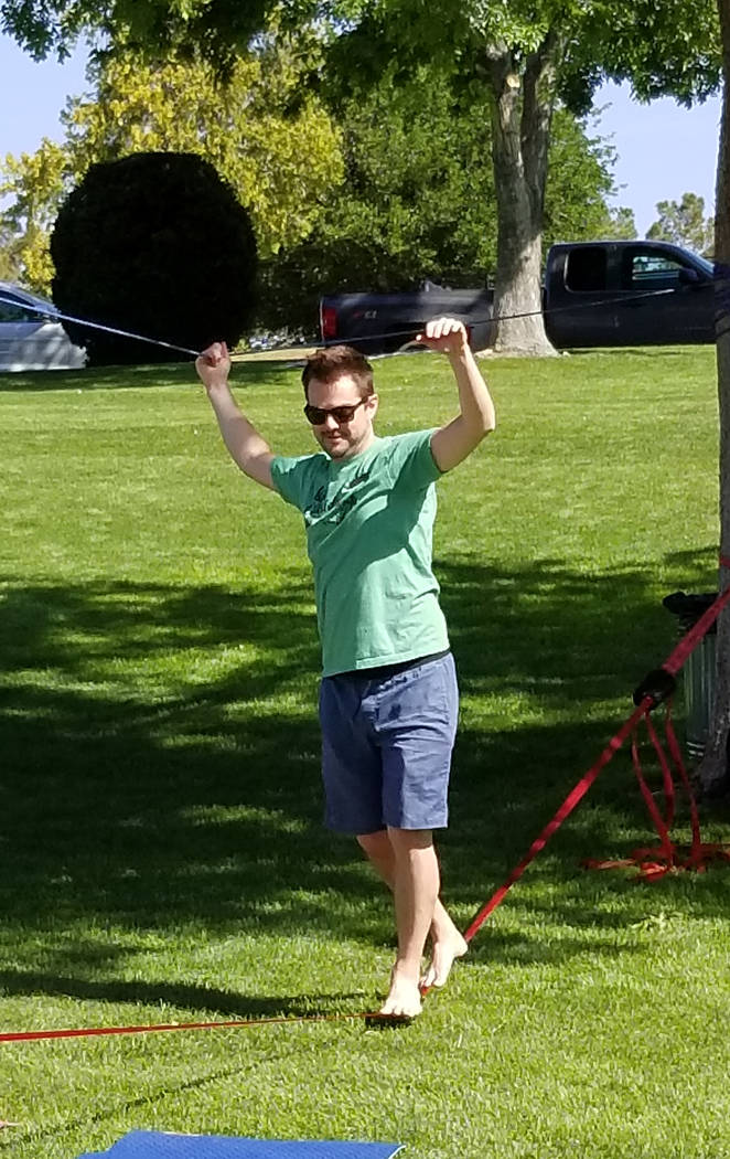 (Celia Shortt Goodyear/Boulder City Review) Matt Marinac tests out the slackline during the Get ...