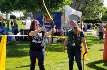 (Celia Shortt Goodyear/Boulder City Review) Amanda Yardley, left, learns how to use a bow and a ...