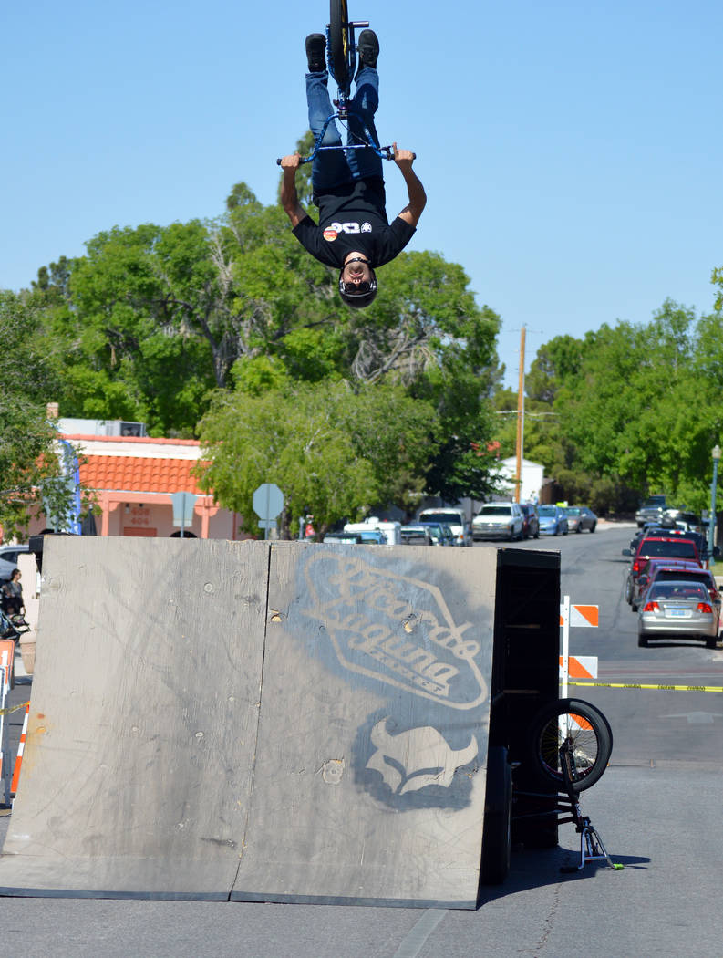 (Celia Shortt Goodyear/Boulder City Review) Aidin Fly performs a flip on his bike during the 42 ...