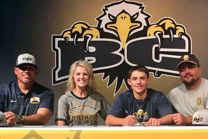(Andrea Moore) Hunter Moore, second from right, signs his letter of intent to join Boulder City ...