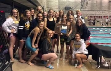 (Amy Wagner) Members of Boulder City High School's girls swim team celebrate winning the region ...